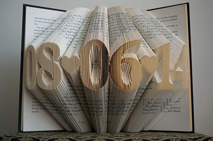 folded paper book sculpture of anniversary date