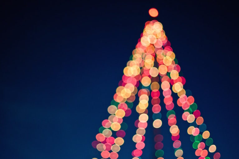 blurred image of Christmas tree made of lights