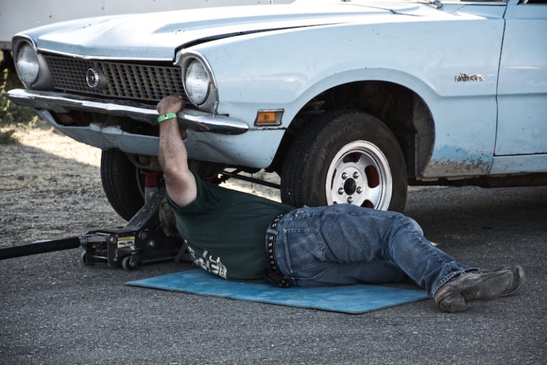 dad working on his car in driveway